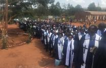 Clergy line up outside St. Peter's United Methodist Church in Gitega, Burundi, for a special Burundi Annual Conference session to celebrate unity within the church. Photo by Tafadzwa Mudambanuki, UMNS.