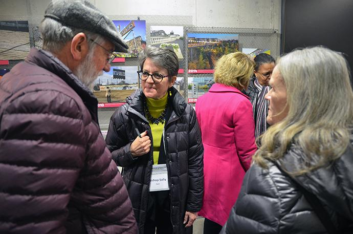 Chicago Area Bishop Sally Dyck speaks with others in the Visitor Center at the Berlin Wall Memorial Bernauer Strasse during the March 15-18 meeting of The United Methodist Board of Church and Society held in Berlin. Photo by the Rev. Klaus U. Ruof