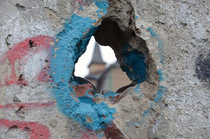A hole in the Berlin Wall on the former east side at the Berlin Wall Memorial Bernauer Strasse shows the steeple of a building on the other side. The United Methodist Board of Church and Society chose Berlin for their conference March 15-18 partly because the formerly divided city stands for upheaval and reconciliation. Photo by the Rev. Klaus U. Ruof.