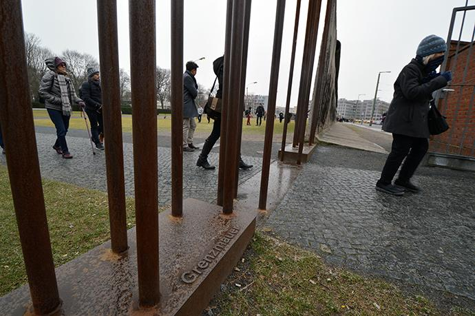 Visitors explore the Berlin Wall Memorial. Metal bars indicate where the boundary of the wall was, with the area to the left being the former East Berlin and to the right, the former West Berlin. Photo by the Rev. Klaus U. Ruof, UMNS.