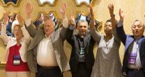 Attendees at the United Methodist Council of Bishops meeting in Chicago join in the
