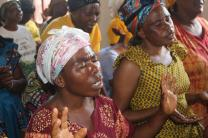 Women pray during a worship service on Christian unity in Bukavu, Democratic Republic of Congo. The Church of Christ in Congo, an ecumenical Christian organization that includes United Methodists, sponsored the women's event. Photo by Philippe Kituka Lolonga, UMNS.