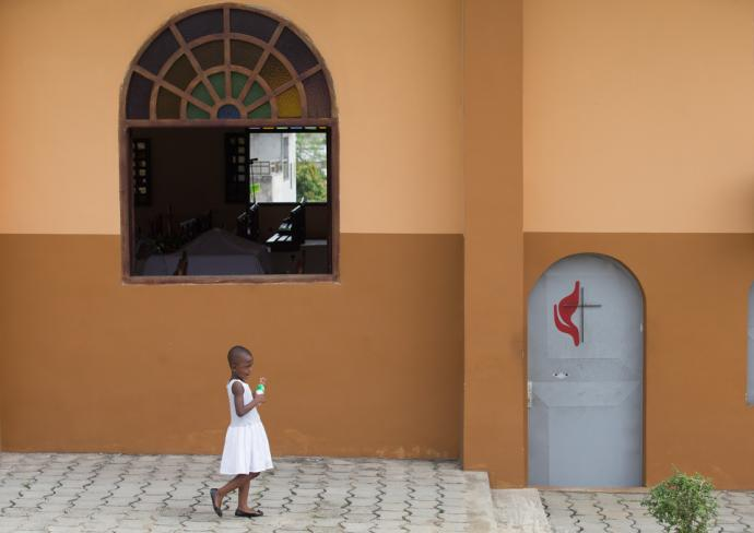 A young girl arrives for Sunday worship at Nazareth United Methodist Church in Abidjan, Côte d'Ivoire. Photo by Mike DuBose, UMNS.