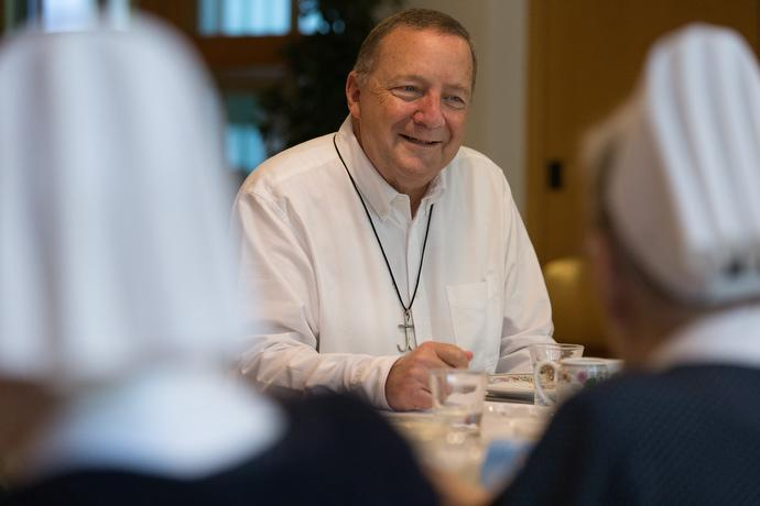 The Rev. George Miller visits with United Methodist deaconesses in Frankfurt, Germany. Miller is a United Methodist missionary and has an office in the building where the sisters live. Photo by Mike DuBose, UMNS.