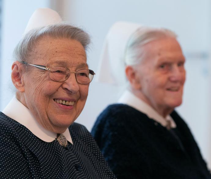 Sisters Lilly Groß (left) and Rose Häußermann enjoy lunch together at their retirement home attached to the United Methodist headquarters in Frankfurt, Germany. Photo by Mike DuBose, UMNS.
