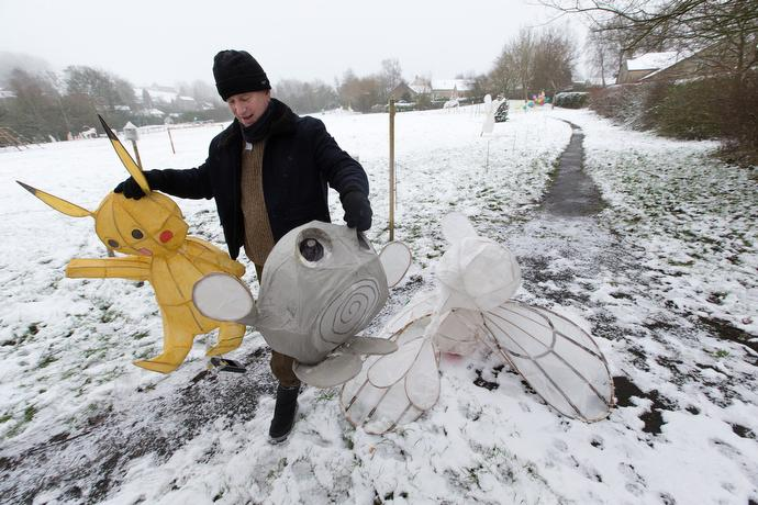 The Rev. Keith Sandow sets out Papier-mâché figures for the Lantern Parade hosted by the Kettleshulme Methodist Church in Northern England.