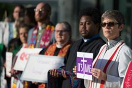 Protestors in support of LGBTQ clergy line the entryway to the 2016 United Methodist General Conference May 18 in Portland, Ore. Many wore or carried clergy stoles of defrocked clergy. Photo by Mike DuBose, UMNS.