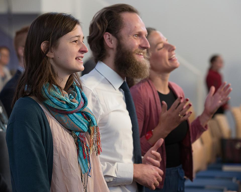 Parishioners sing during worship at the United Methodist Church of the Redeemer in Munich, Germany. From left are Jula Carlsen and Daniel  and Carina Kuß. Photo by Mike DuBose, UMNS.