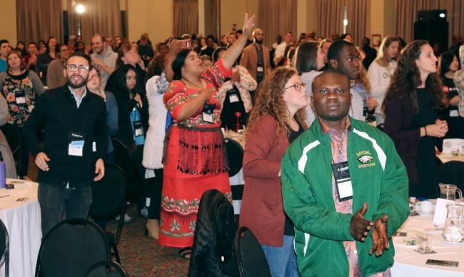 Delegates sing during worship at the Global Young People's Convocation. The gathering brings together young United Methodists from 40 countries to discuss issues affecting young people and unity in the church. Photo by Eveline Chikwanah.
