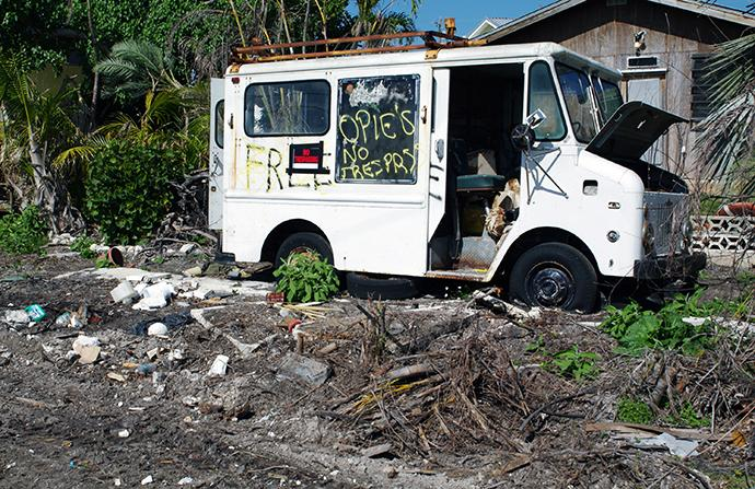 A heavily damaged service truck sits in the yard of an abandoned home in Big Pine Key, Fla. Photo by Gustavo Vasquez, UMNS.