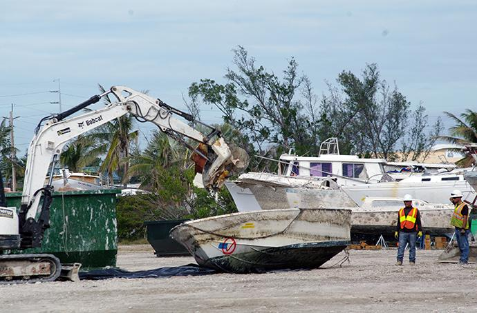 A closed golf course in Marathon Key, Fla., has become a makeshift site where boats that were unmoored and damaged by Hurricane Irma are demolished. Photo by Joey Butler, UMNS.