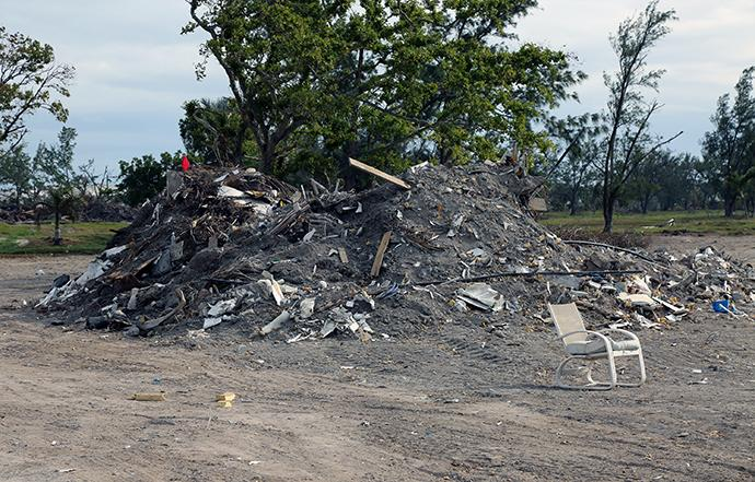 Debris from Hurricane Irma sits in massive piles on an abandoned golf course in Marathon, Fla.  Photo by Deborah Coble, Florida Conference.