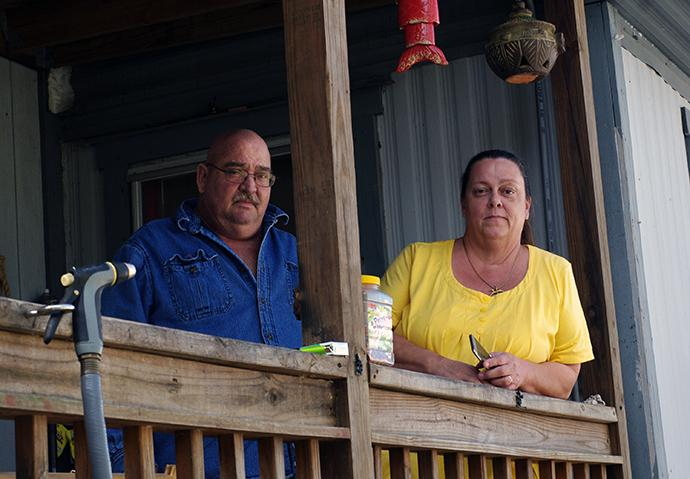 Bomar (left) and Diana Kelley pose outside their Big Pine Key, Fla., home, which suffered significant damage when Hurricane Irma struck Florida on Sept. 10, 2017. Photo by Gustavo Vasquez, UMNS.