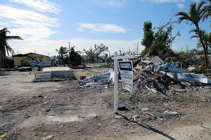 A realtor's sign stands in front of a razed house in Big Pine Key, Fla. Photo by Deborah Coble, Florida Conference.