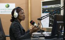 Viviane Daho broadcasts from The United Methodist Church's Voice of Hope radio station in Abidjan, Côte d'Ivoire. Photo by Mike DuBose, UMNS.