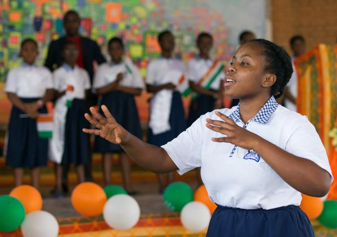 Maruela Kpanigo leads the choir at the United Methodist Anyama School in Abidjan. Photo by Mike DuBose.