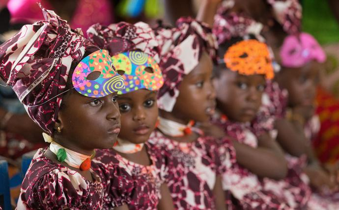 Students wearing Mardi Gras costumes listen to their teacher at the United Methodist Anyama School in Abidjan. Photo by Mike DuBose, UMNS.