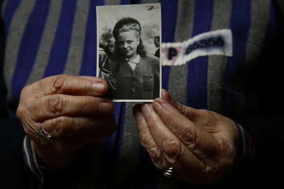 Auschwitz death camp survivor Jadwiga Bogucka-Regulska holds a photo of herself from 1944. She was 89 when she posed for this photo in 2015 for a Reuters feature on the 70th anniversary of the liberation of the Nazi camp. She joined the Methodist Church just after World War II.