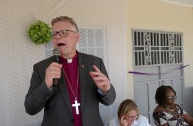 Norwegian Bishop Christian Alsted of the Nordic-Baltic Episcopal Area prays for the new health center and the people of Joyah, Sierra Leone. Photo by Phileas Jusu, UMNS.
