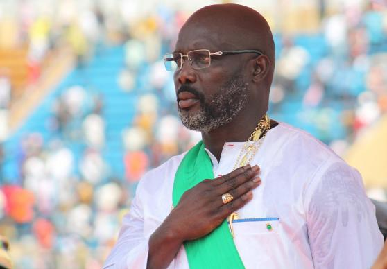 George Manneh Weah salutes during the playing of Liberia's national anthem at his inauguration as the country's 24th president at Samuel Doe stadium in Monrovia. Weah, a United Methodist and former soccer star, was elected by more than 61 percent of the vote. Photo by E Julu Swen, UMNS.