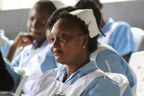 Yah Dorliea, a United Methodist University nursing student, listens intently during a ceremony consecrating the new nursing school in Ganta, Liberia. The school is part of the Winifred J. Harley College of Health Sciences. Photo by E Julu Swen, UMNS.