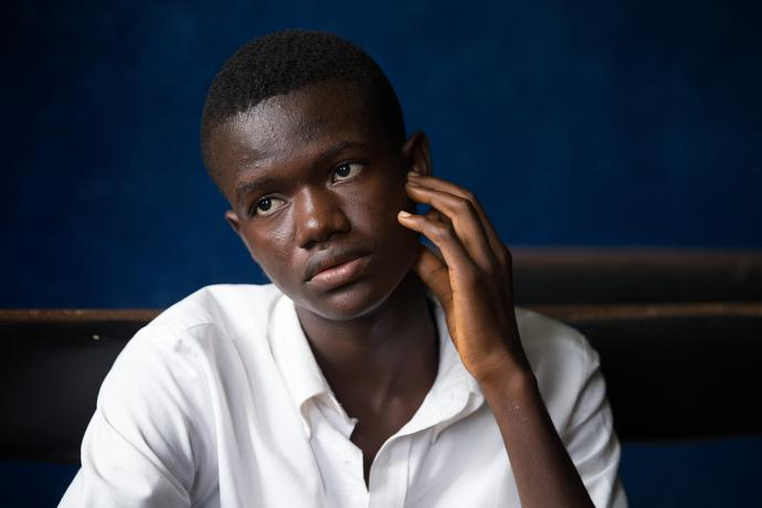 """Abullah Buhmean, 17, was able to continue his education at Ganta United Methodist School after his uncle died of Ebola thanks to a work grant from the school. """"We were quarantined for 21 days when it was confirmed by the hospital that my uncle had Ebola,"""" Buhmean said. Photo by Mike DuBose, UMNS."""