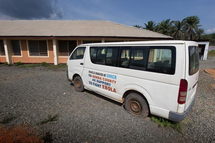 A van donated by the United Nations to help fight Ebola rests on flattened tires at a former containment facility near the airstrip at the United Methodist Ganta Mission Station in Ganta, Liberia. Photo by Mike DuBose, UMNS.