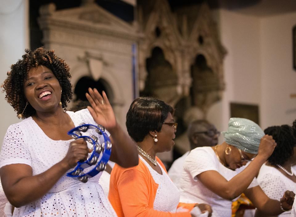 Harriet Appiah-Anderson (left) sings with the choir at Wesley's Chapel in London. She is chair of the church's Ghanaian fellowship. Photo by Mike DuBose, UMNS.