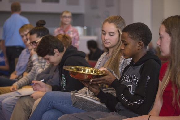 Young adults pass the collection plate during the contemporary worship at McKendree United Methodist Church in Lawrenceville, Ga. 2016 file photo by Kathleen Barry, UMNS.
