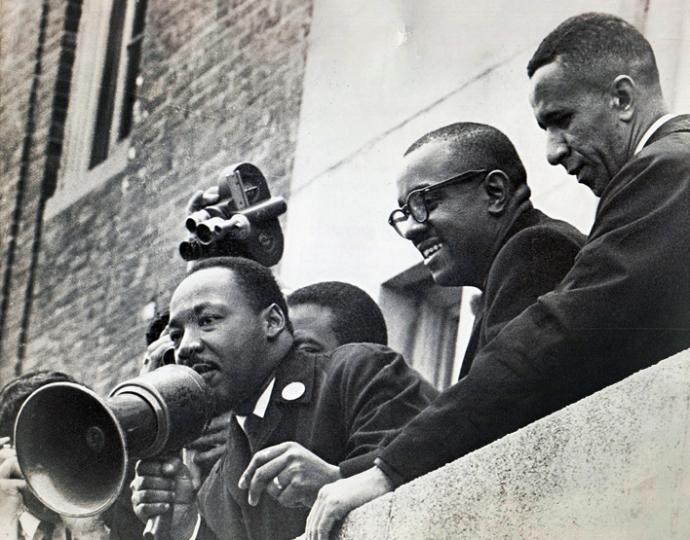The Rev. Gilbert H. Caldwell (right) stands with the Revs. Martin Luther King Jr. (left) and Virgil Wood on the roof of a Boston public school in 1965. Photo courtesy of the Rev. Gilbert H. Caldwell.