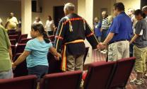 Attendees of the 2017 Native American Summer Conference at Lake Junaluska, N.C., form a circle in prayer. Photo by Kathleen Barry, United Methodist Communications.