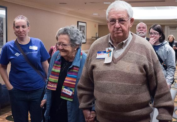 Nora and Paul Meredith, parents of the Rev. David Meredith, walk to hearing concerning their son held March 9 in Indianapolis Hilton.