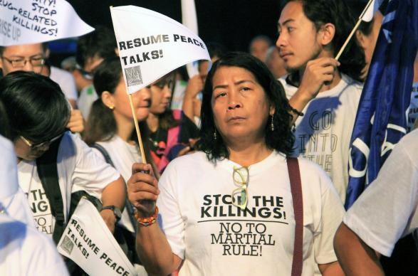 Ofelia A. Cantor, a laywoman from Village United Methodist Church, holds a sign asking for peace talks to resume at the Walk for Life rally Feb. 24 in Manila, Philippines. United Methodists joined the ecumenical gathering to protest Philippine President Rodrigo Duterte's war on drugs. Photo courtesy of Jsr Grafix.