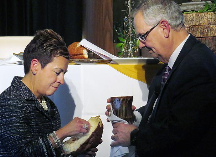 Council of Bishops Secretary Cynthia Fierro Harvey and Council of Bishops President Bruce R. Ough share the elements during Holy Communion, part of the Feb. 25 opening worship service for the council's meeting in Dallas. The bishops will meet through Wednesday, Feb. 28, and will be refining denominational unity options put forward by the Commission on a Way Forward. Photo by Sam Hodges, UMNS.