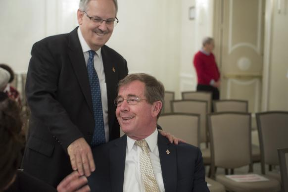 Bishop Bruce R. Ough (left) greets Bishop Scott Jones prior to the May 22 oral hearing before the United Methodist Judicial Council in Evanston, Ill. The two argued different positions before the court. Photo by Kathleen Barry, UMNS