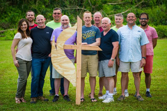 The South Carolina mission team poses with a handcrafted cross and flame they made for the Methodist Camp in Arecibo, Puerto Rico, where the team was housed. Photo by Matt Brodie.