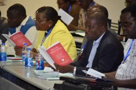 Attendees study of a Social Principles Training at Africa University in 2017 study their copies of the principles. File photo courtesy of Church and Society.