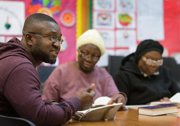 Eric Bediako (left) leads a Bible study with Judith Alpha (center) and Joyce Davies at Bermondsey Central Hall Methodist Church. Photo by Mike DuBose, UMNS.