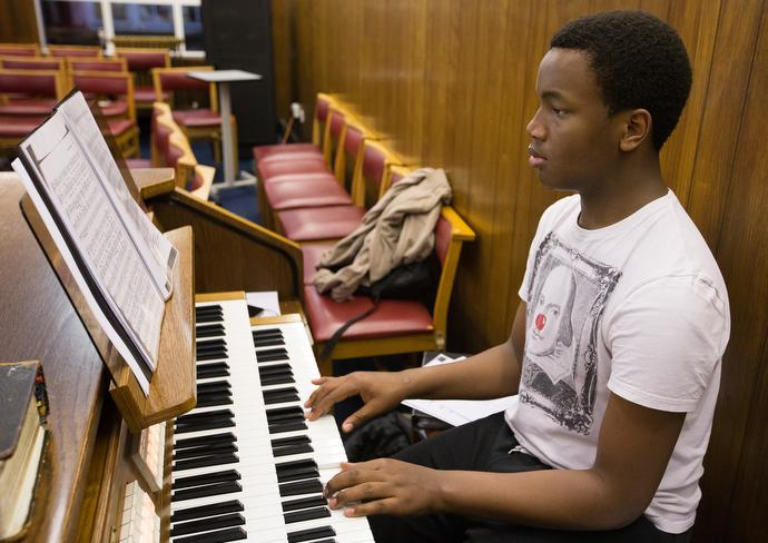 """Winston Shaw, 17, stops by after school to practice the organ at Bermondsey Central Hall Methodist Church. """"I try to repay my love for God through music,"""" Shaw said. Photo by Mike DuBose, UMNS."""