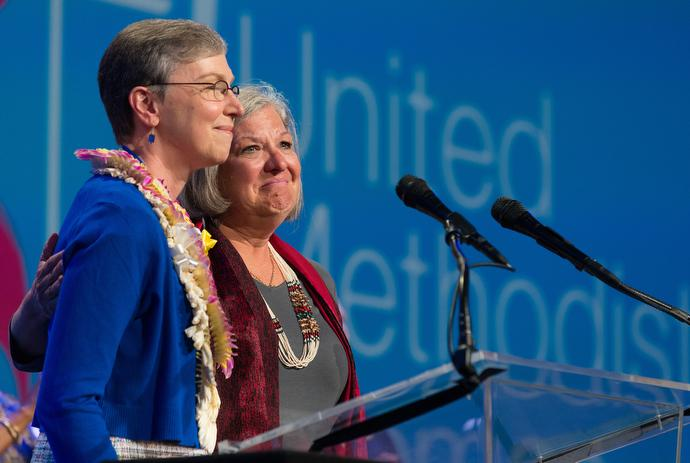 Dawn Wiggins Hare (right), of the United Methodist Commission on the Status and Role of Women, becomes emotional as she and Harriett Jane Olson lament the failure of two amendments to the church's constitution that promoted women's equality. Photo by Mike DuBose, UMNS.