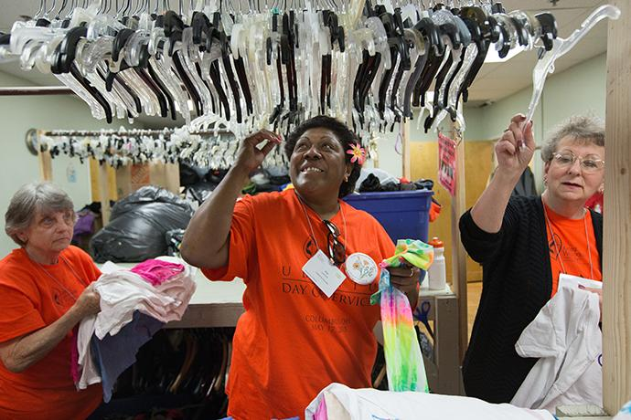 Vini Lanford (center) of the California-Nevada Conference helps sort donated clothing at the Free Store at United Methodist Church for All People in Columbus, Ohio, as part of the Ubuntu Day of Service during the United Methodist Women Assembly 2018 in Columbus, Ohio. Working with her are Cheryl Diane Almack and Cheryl Anne Jones of the Iowa Conference. Photo by Mike DuBose, UMNS.