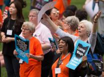 Deaconess Evana Lewis (front) of the New York Conference joins other United Methodist Women in a rally for a fair living wage on the steps of the Ohio Statehouse in Columbus during the United Methodist Women Assembly 2018. Photo by Mike DuBose, UMNS.