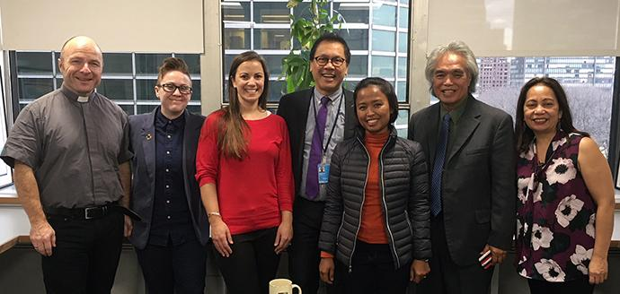 "Among those taking part in the Jan. 22 U.N. symposium on migration were, from left, the Rev. Hans Martin Hoyer of Germany; Quinn Wonderling, Rebecca Cole and the Rev. Liberato ""Levi"" Bautista, all staff with the United Methodist Board of Church and Society; the Rev. Eni Lestari Andayani Adi, International Migrants Alliance; Leon Siu, foreign minister of the Kingdom of Hawaii and Connie Sorio, coordinator of migrant justice and (Asia-Pacific) partnership for KAIROS: Canadian Ecumenical Justice Initiatives. Photo courtesy of the Board of Church and Society."