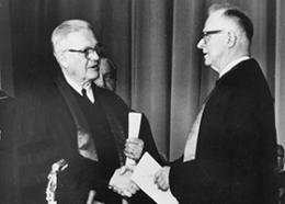 Evangelical United Brethren Church Bishop Reuben H. Mueller (left) and Methodist Bishop Lloyd C. Wicke join hands on April 23, 1968, symbolizing the merger between the two denominations. 1968 file photo courtesy of the United Methodist Commission on Archives and History.