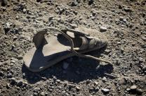 An abandoned sandal lies just across the border from Mexico near Friendship Park in San Diego. 2012 file photo by Mike DuBose, UMNS.