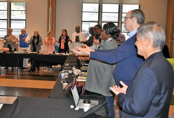 Members of the Commission on a Way Forward participate in a letting-go prayer at the end of their four-day meeting at El Segundo United Methodist Church in Los Angeles on Thursday, March 22. Photo by Maidstone Mulenga, Council of Bishops.