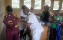 A student at Murewa United Methodist Mission School receives a human papillomavirus vaccine. The vaccine protects against cervical cancer. Photo by Sydney Mapisaunga, deputy head of the school.