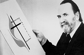 Artist Edward J. Mikula poses with the Cross and Flame emblem he had designed in 1968. This photo is from the book Keeping Up With The Revolution by Edwin Maynard. Archived Photo, United Methodist Communications.