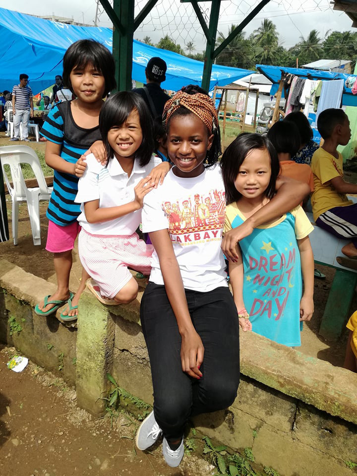 Miracle Osman, center front, has been unable to leave the Philippines voluntarily after her passport was confiscated as she was extending a tourist visa while waiting for her missionary visa. Photo courtesy of the United Methodist Board of Global Ministries.