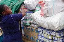 Silvia Munjoma, vice chairwoman for St. John's Church and Society committee, helps unload donations at Mutare Provisional Remand Prison in Zimbabwe. Photo by Kudzai Chingwe, UMNS